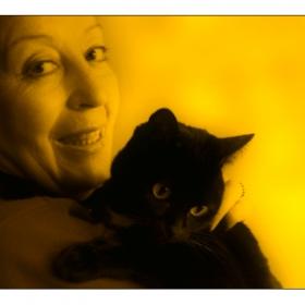 A Woman & A Black Cat