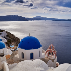 Santorini's famous blue domed tree bells church