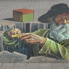 Международен стрийт арт фест 3D в градска среда - рисунки върху плочките на площада в центъра на Русе Авторът е художник от Италия